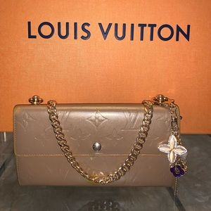 Louis Vuitton gold bronze wallet with charm